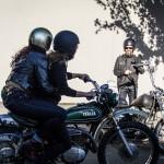 Lanakila MacNaughton rides with Emily George on motorcycle, Tony waves