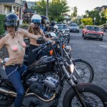 Michelle Clabby & Jenny Czinder say hello before riding topless through Portland with nipple pasties