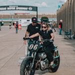 Builder and racer Malary Lee rides her Royal Enfield BuildTrainRace bike out of the NASCAR garage